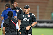 Highlands Park coach Owen Da Gama with Rhulani Mokwena during the Absa Premiership match between Highlands Park and Orlando Pirates at Makhulong Stadium on October 29, 2019 in Johannesburg, South Africa.