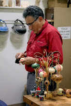 Photo: Clif Poodry before the demonstration with examples of the ornaments he will be turning in the demonstration.