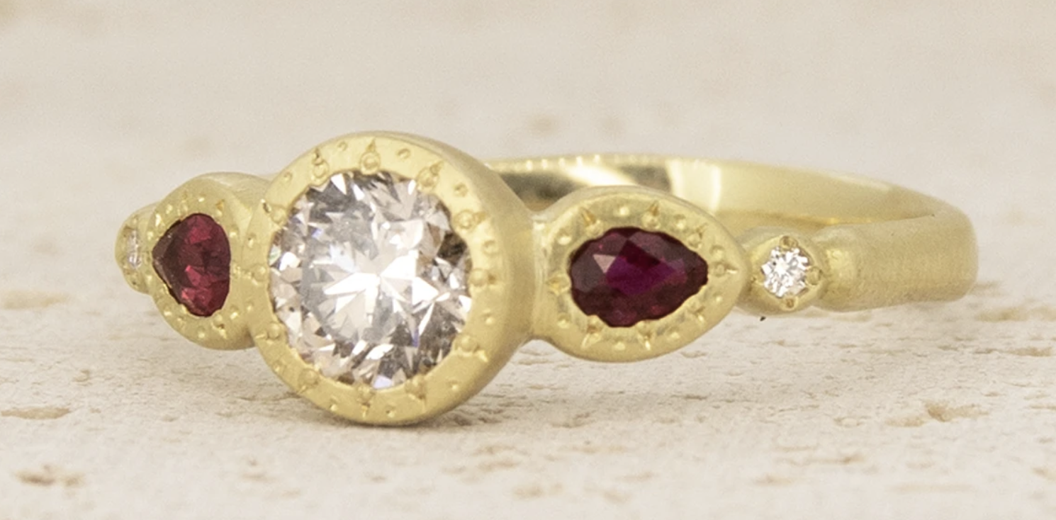 ring with pear ruby sides