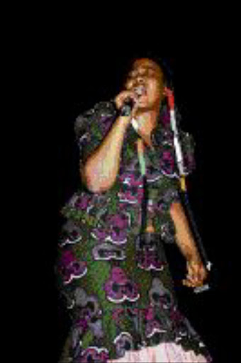 FIRED-UP: Thandiswa Mazwai at the Divas in Concert at Bassline in Newtown. Pic: MOHAU MOFOKENG.  23/08/2009. © Sowetan.