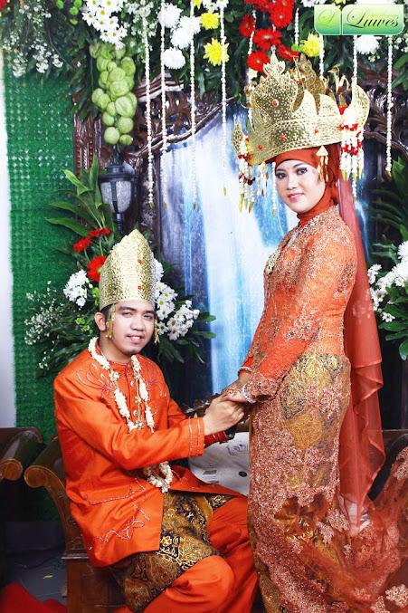 Rias pengantin dengan adat sumatra