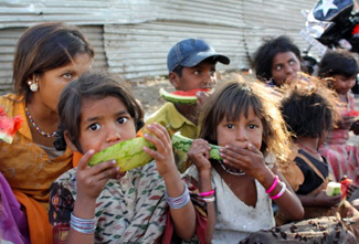 children eating in india
