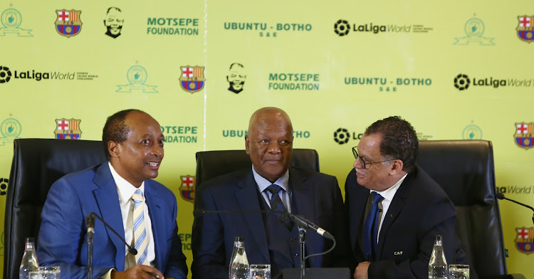 Mamelodi Sundowns president Patrice Motsepe (L), Energy Minister Jeff Radebe (C) and SA Football Association president Danny Jordaan (R) at a press conference at Sandton Convention Centre, Johannesburg, on Thursday May 10 2013.