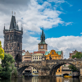 by Mario Horvat - Buildings & Architecture Bridges & Suspended Structures ( sky, prague, bridge, river, clouds, water, building, tower )