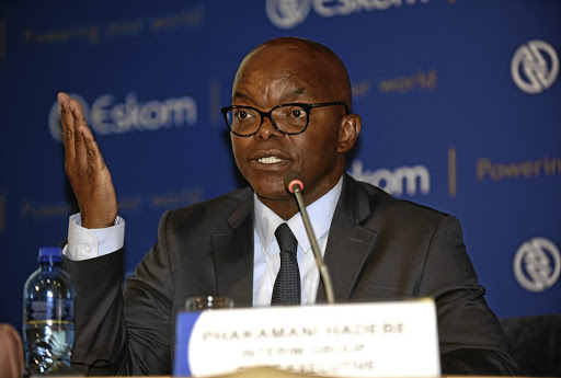 Angry workers threw water bottles at Eskom CEO Phakamani Hadebe.