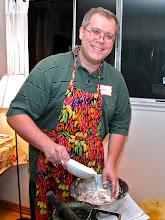 Photo: Jason adding tapioca starch to grated taro