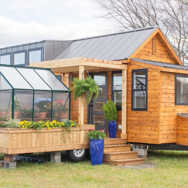 Tour This Tiny Home With A Porch And Greenhouse – You Won't Believe That It's Fully Mobile