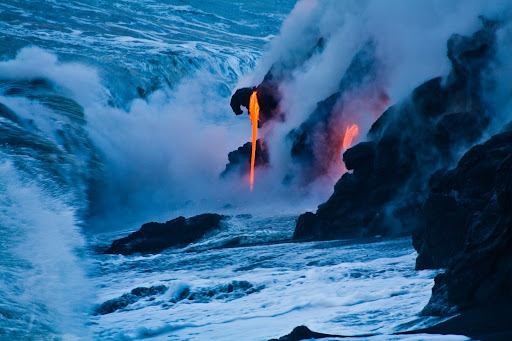 hawaii.jpg - Blue and orange converge as lava enters the sea at dusk at Pahoa on the Big Island of Hawaii.