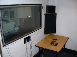 Photo: Patient sound booth for on site hearing testing.