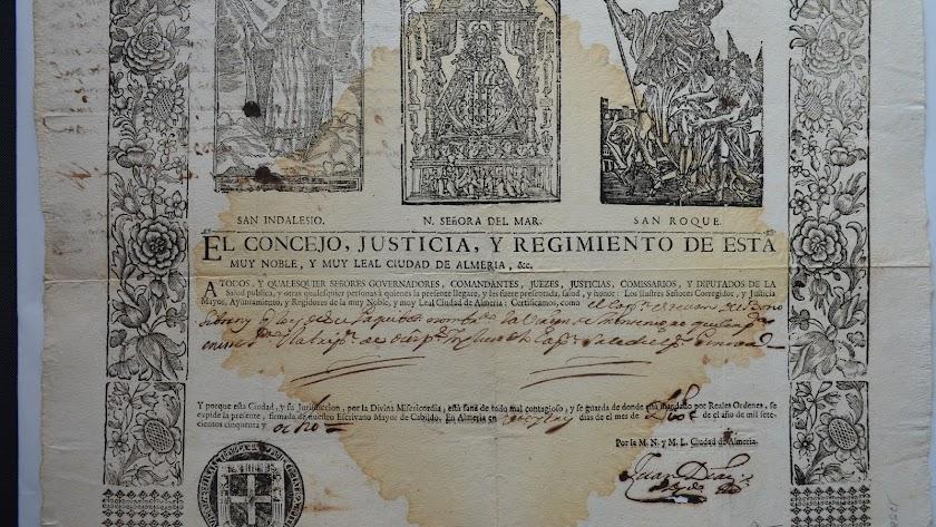 Patente encabezada por la pretendida Virgen del Mar, en realidad Virgen de la Consolación de Utrera, entre San Indalecio y San Roque. Fotos: AGA.