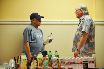 Photo: Raul Sanchez and William Scott Galasso guarding the snacks and drinks.