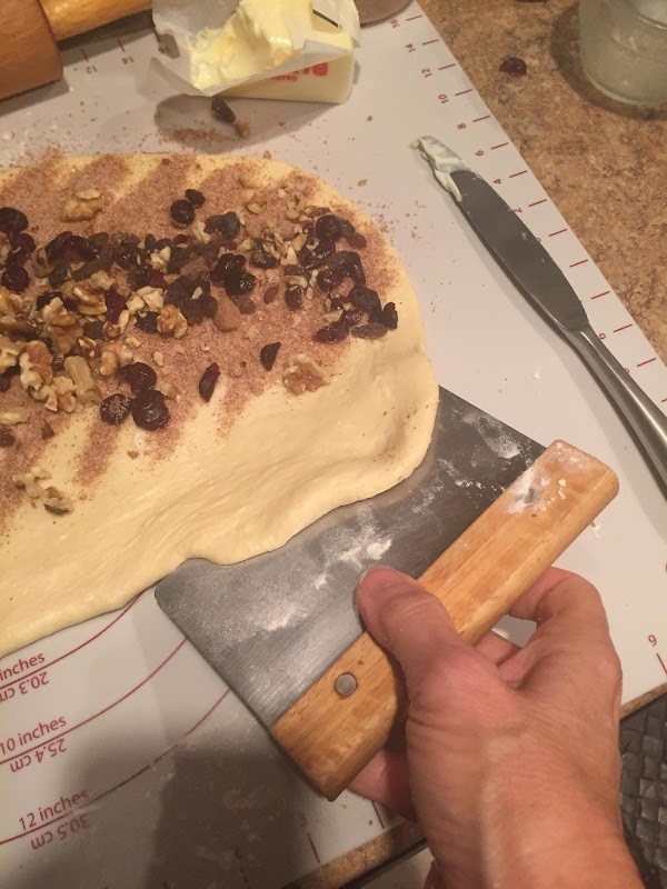Fold the top third of the dough over the middle third. It will be...