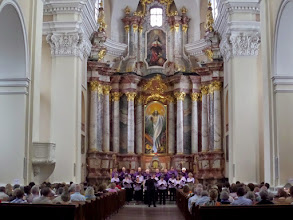 Photo: Saint Casimir is now once again a Catholic church. Inside, a beautiful recital is being song by a small choir.