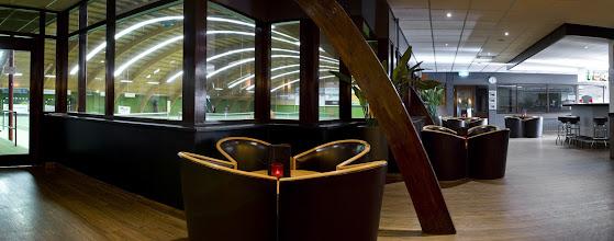 Photo: Hotel bar overlooking the indoor tennis courts