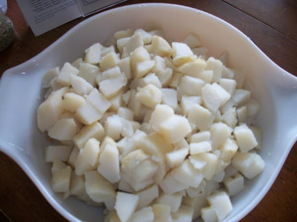 First peel your cooked, cooled potatoes. Cut each one into 3/4 inch slices, then...
