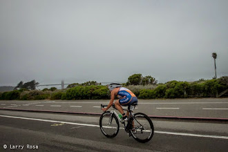Photo: Erika Erickson (USA) rides in the early morning fog at the 2014 Escape from Alcatraz Triathlon on June 1, 2014 in San Francisco, CA