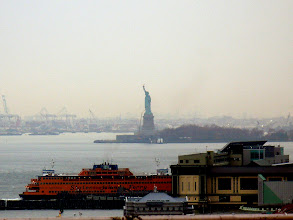 "Photo: The Statue of Liberty using a telephoto setting on my Panasonic DMC-LZ7.  ""The New Colossus"" Give me your tired, your poor, Your huddled masses yearning to breathe free, The wretched refuse of your teeming shore. Send these, the homeless, tempest-tost to me. I lift my lamp beside the golden door.      -- Emma Lazarus, 1883  http://www.nyc-architecture.com/LM/LM002-STATUEOFLIBERTY.htm  http://kalman.blogs.nytimes.com/2009/08/27/i-lift-my-lamp-beside-the-golden-door/"