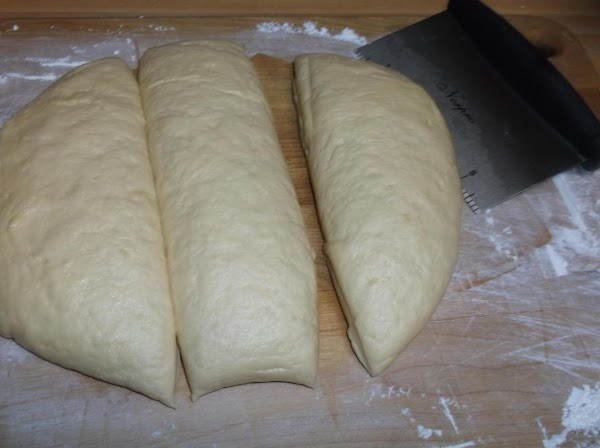 Cut dough into 3 equal pieces.