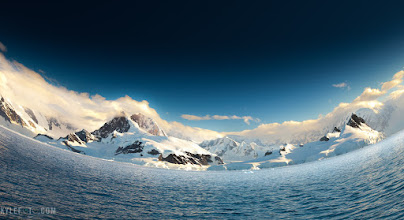 Photo: Digital fisheye Antarctic Vista Antarctica From the blog http://www.kylefoto.com/2011/11/digital-fisheye-antarctic-vista/  The views that welcome you when you first arrive along the Antarctic continent is quite the sight to behold. Being surrounded by these tall icy figures rising out of the ocean feels like the mountains are hugging you, and despite the cool the antarctic air I always feel warm and fuzzy. This is one of the images I used to promote my Polar Worlds show.  Photographic Details: Fisheye photos are cool but to use one regularly would be somewhat disorientating. The original shot had a flat horizon but I wanted something a little more dynamic. So instead of going out to get a fisheye I thought I would make the effect myself, turns out it's possible in photoshop in about 7 clicks of the mouse!  Full tutorial with screenshots is here! http://www.kylefoto.com/2011/11/digital-fisheye-antarctic-vista/   Canon EOS 5D, 1/100s f/5.0 ISO50 35mm 16-35mm f2.8 L lens.  If you like this, please share. And if you try this technique, post it in the comments and share, let's see what you can do!