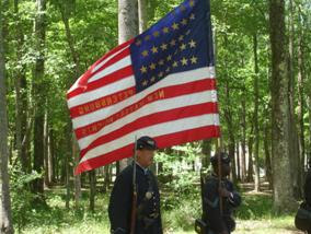 Photo: Cpl's Leon Brooks and Larry Harris guard the colors at the battle at Fort Pocahontas