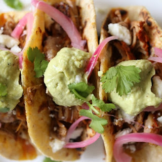 Achiote Pork Tacos with Avocado-Tomatillo Salsa and Pickled Onions.