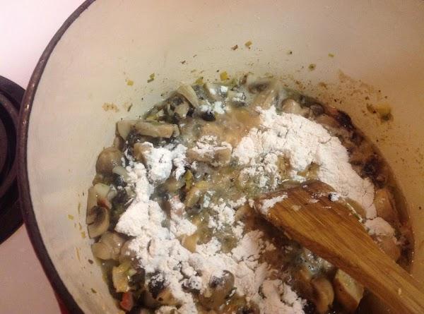 Add flour and stir to make a roux.