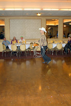 """Photo: Tom Jones, Southwest Sales, takes his horse """"Princess"""" for a victory ride around the dance floor."""