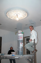 Photo: February 2006 - Month 30: Installing the ceiling medallion in the dining room - Phase 1 center shadow box.