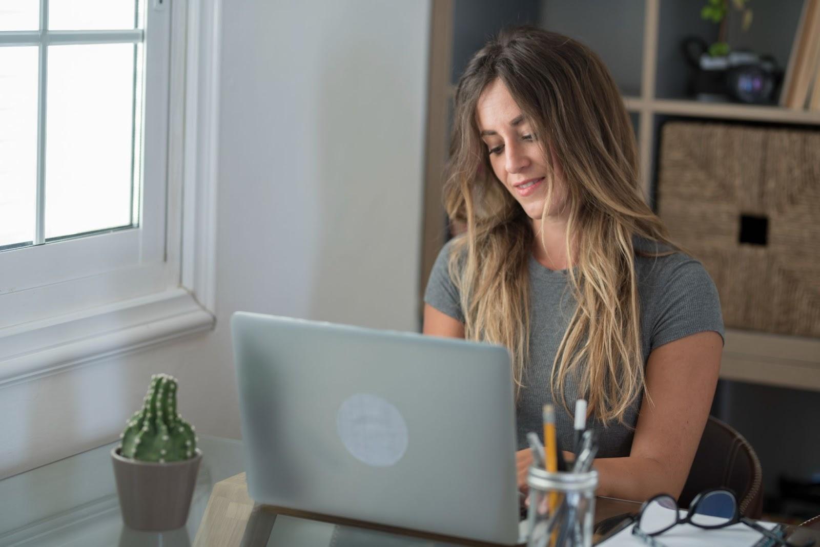 Woman browsing web on laptop