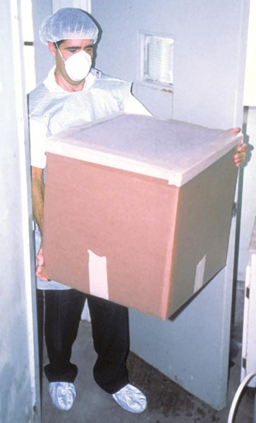 A cap, mask, coveralls or gown, boots, disposable containers and air filtration with HEPA-filters are used at a USDA pet bird quarantine facility