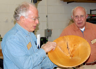 Photo: Phil shows another bowl with the grain pattern from the crotch along the side of the bowl.