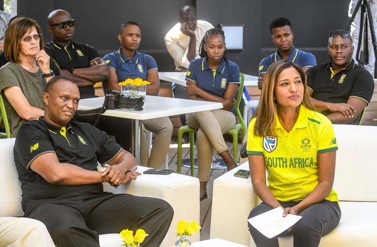 SA senior women's cricket head coach Hilton Moreeng (L) and TV and radio presenter and commentator Kass Naidoo (R) with Proteas ladies players in the background during the Proteas Women's send-off to ICC Women's World T20 at Cricket SA Head Offices in Johannesburg on October 23, 2018.