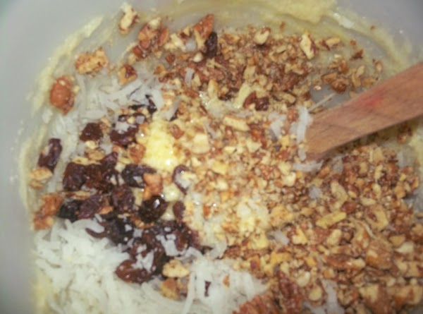 Add eggs, vinegar, vanilla and beat well. Add pecans, raisins and coconut and mix...
