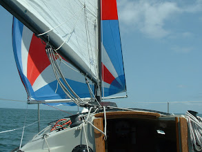 Photo: Single handed and flying the spinaker.