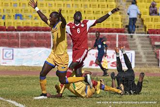 Photo: Ernest SUGIRA (16) celebrates  Jean-Baptiste MUGIRANEZA's (7)equaliser [Rwanda vs Sudan, CECAFA 2015, Semi final, 3 Dec 2015 in Addis Ababa, Ethiopia.  Photo © Darren McKinstry 2015, www.XtraTimeSports.net]