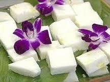 Haupia.  A Hawaiian Luau Staple.  It's Deliciously Sweet, And The Consistency Of A Thick Jello Chunk, As It's More Gelatin-based Than Pudding Textured.