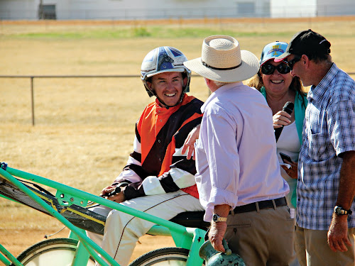Josh Osborn being congratulated by Narrabri club president Peter Shepherdson after winning last year's Narrabri Cup onboard Samuel Thomas at the Narrabri Showground. North West Harness Racing's Julie Maughan and winning trainer Anthony Missen are on the right.