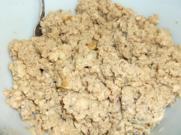 Using well-washed hands (food service gloves recommended,) mix lightly, add torn white bread crumbs...