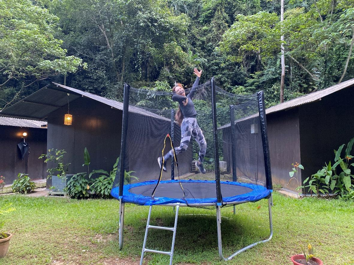 A person on a trampolineDescription automatically generated with medium confidence