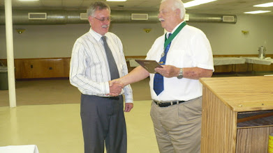 Photo: Past Grand Knight Rich Cook presenting the Knight of the Year award for 2011-2012 to Brother Ed Hardy.