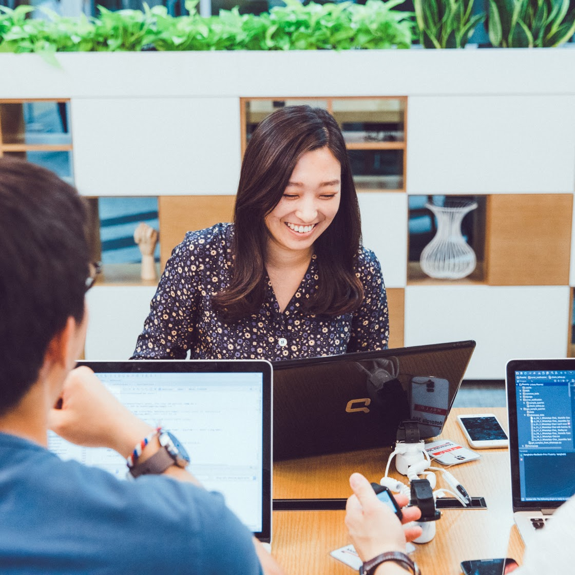 Woman smiling at laptop with others, Sales Academy, Campus Seoul, Google for Startups