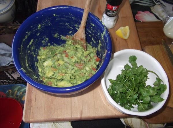 Add avocado chunks and mash slightly (should still be kinda chunky)...i use potato masher....