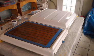 Photo: companionway cover and turtle with 1 coat of brightsides