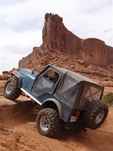 Photo: Merrimac Butte behind the Kakabeka Offroad Centre Jeep in Moab