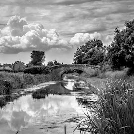 Canal Bridge by Nicole Williams - Black & White Buildings & Architecture ( clouds, sky, bridge, canal )