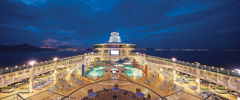 Step onto the main deck at night for a cool sea breeze on Mariner of the Seas.