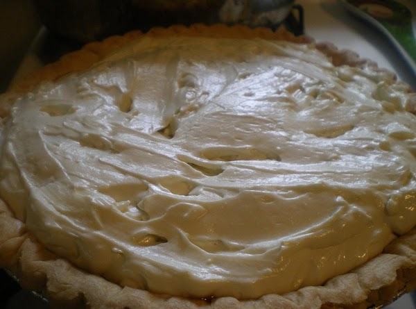 Gently smooth cream cheese layer with a spatula or spoon making sure cream cheese...