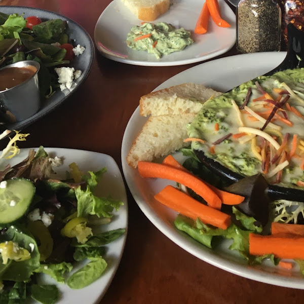 Greek salad and spinach artichoke dip