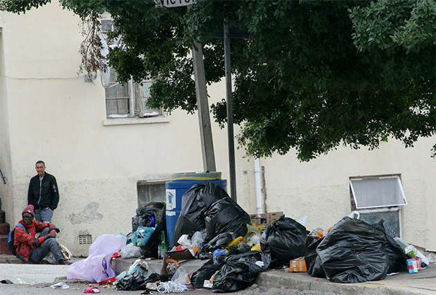 Uncollected refuse litters the streets and pavements of Central and Lorraine as the municipal workers' strike continues