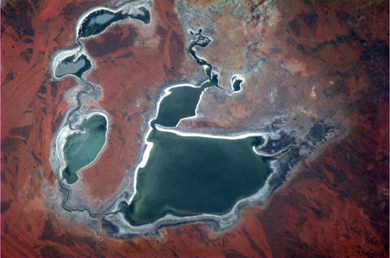 Photo: Australia - the dryness creates colours and textures that make the Outback immediately recognizable from space.